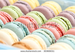 stock-photo-box-of-fresh-colorful-macarons-extreme-shallow-depth-of-field-with-selective-focus-on-center-303606311